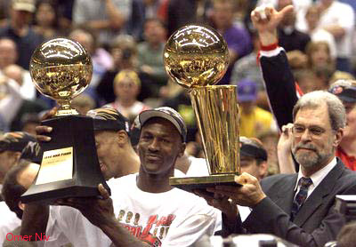 Holds The Larry OBrien Championship Trophy And Michael Jordan His MVP After They Defeated Utah 87 86 To Win NBA June 14